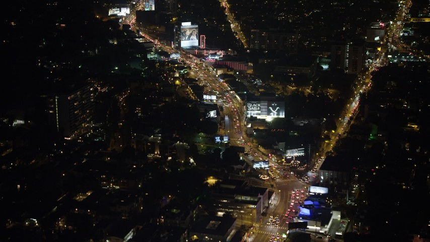 5K stock footage aerial video of flying over the Sunset Strip, West Hollywood, California, night Aerial Stock Footage | AX64_0328