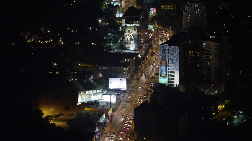 5K stock footage aerial video fly over cars on the Sunset Strip, West Hollywood, California, night Aerial Stock Footage AX64_0329 | Axiom Images