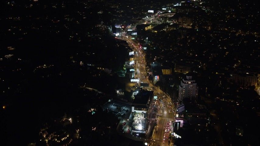 5K stock footage aerial video of Sunset Strip in West Hollywood, California, night Aerial Stock Footage | AX64_0330