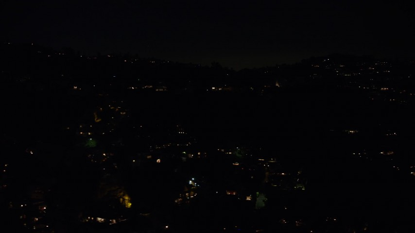 5K stock footage aerial video of residential lights from hillside mansions in Hollywood Hills, Los Angeles, California, night Aerial Stock Footage | AX64_0331