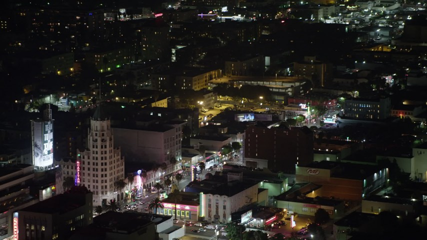 5K stock footage aerial video of shops and office buildings on Hollywood Boulevard, California, night Aerial Stock Footage | AX64_0335