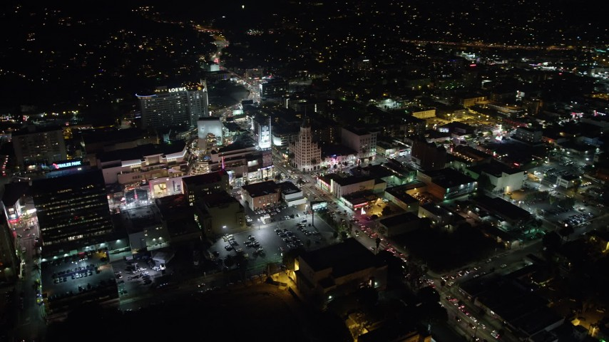 5K stock footage aerial video of Hollywood and Highland Center and office buildings on Hollywood Boulevard, California, night Aerial Stock Footage | AX64_0336