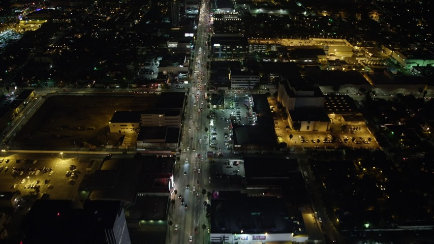 5K stock footage aerial video of Sunset Boulevard and office buildings, Hollywood, California, night Aerial Stock Footage | AX64_0338