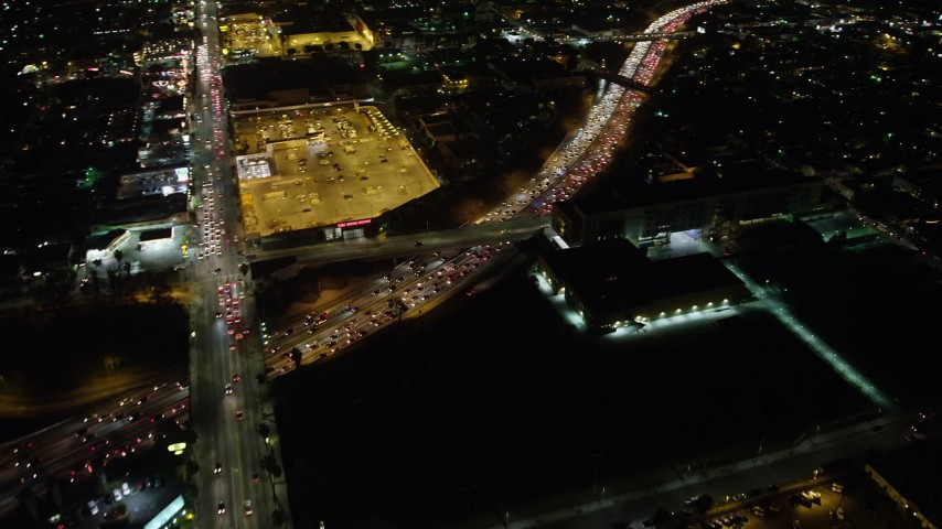 5K stock footage aerial video of Sunset Boulevard and Highway 101 with traffic, Hollywood, California, night Aerial Stock Footage | AX64_0339