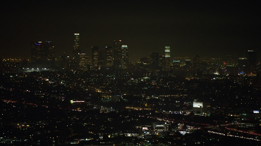 5K stock footage aerial video of passing the Downtown Los Angeles skyline at night, California Aerial Stock Footage | AX64_0341