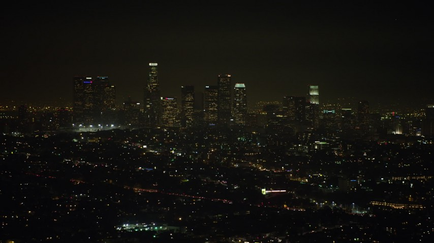 5K stock footage aerial video of a view of the Downtown Los Angeles skyline at night, California Aerial Stock Footage | AX64_0342