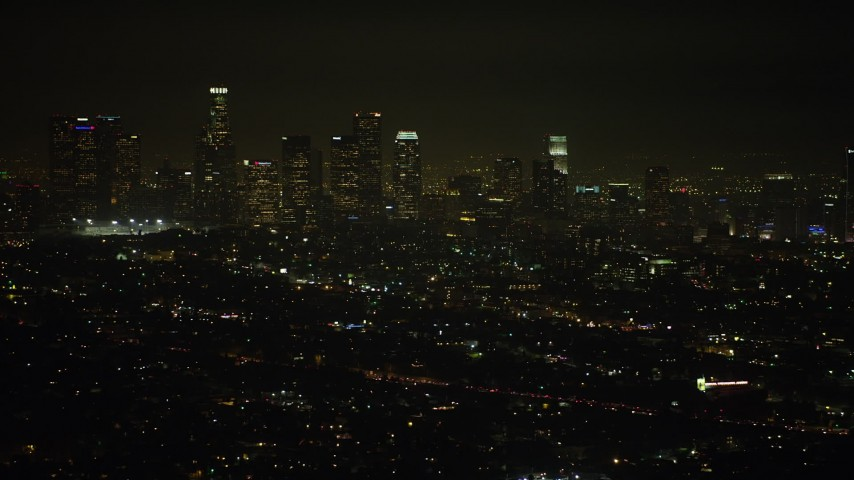 5K stock footage aerial video flyby the Downtown Los Angeles skyline at night, California Aerial Stock Footage | AX64_0343