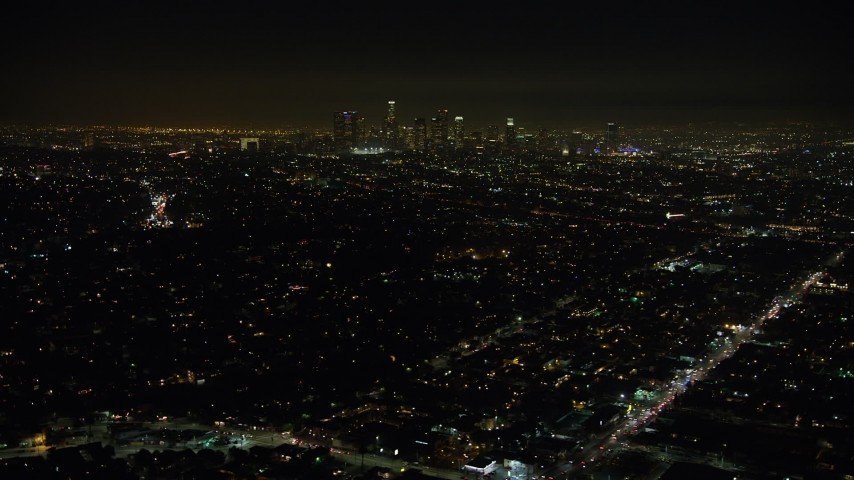 5K stock footage aerial video of a view of the Downtown Los Angeles skyline and city sprawl, California, night Aerial Stock Footage | AX64_0344