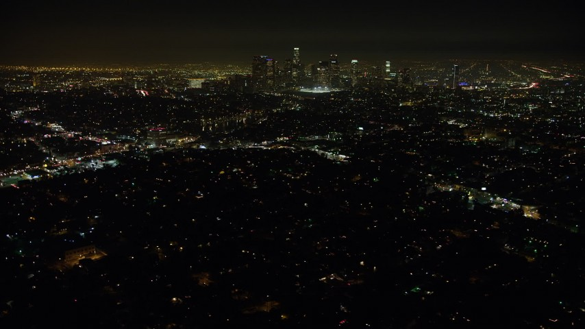 5K aerial video of Downtown Los Angeles skyline and city sprawl seen from Echo Park, California, night Aerial Stock Footage | AX64_0347