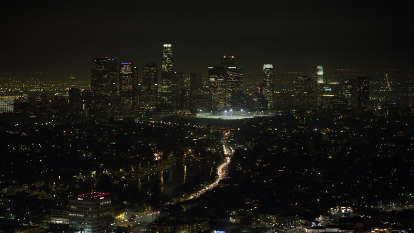 5K stock footage aerial video of Downtown Los Angeles skyline viewed from Echo Lake, California, night Aerial Stock Footage | AX64_0348