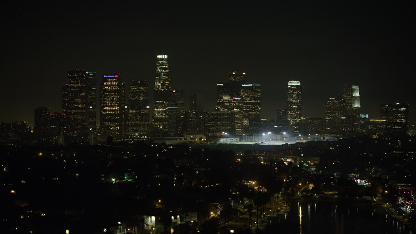 5K aerial video of Downtown Los Angeles skyline at night seen from Echo Lake, California Aerial Stock Footage | AX64_0351
