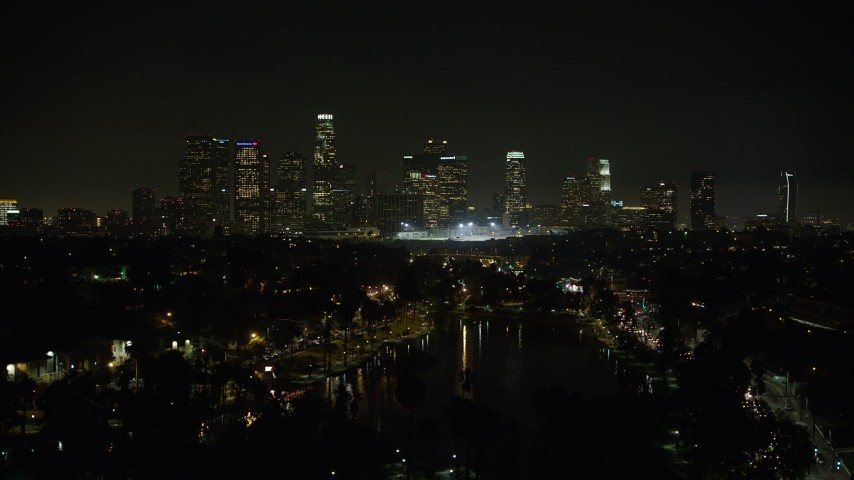 5K stock footage aerial video fly over Echo Lake to approach Downtown Los Angeles skyline at night, California Aerial Stock Footage | AX64_0353