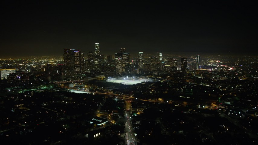 5K stock footage aerial video approach sports fields and Downtown Los Angeles skyline at night, California Aerial Stock Footage | AX64_0355