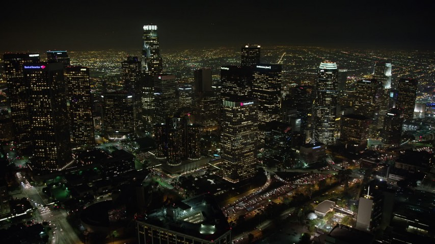 5K stock footage aerial video flying over Westin Bonaventure to approach Downtown Los Angeles skyscrapers, California, night Aerial Stock Footage | AX64_0357