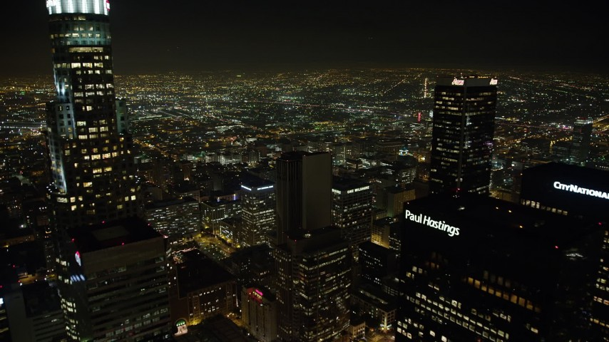 5K stock footage aerial video fly between skyscrapers in Downtown Los Angeles, California, night Aerial Stock Footage | AX64_0358