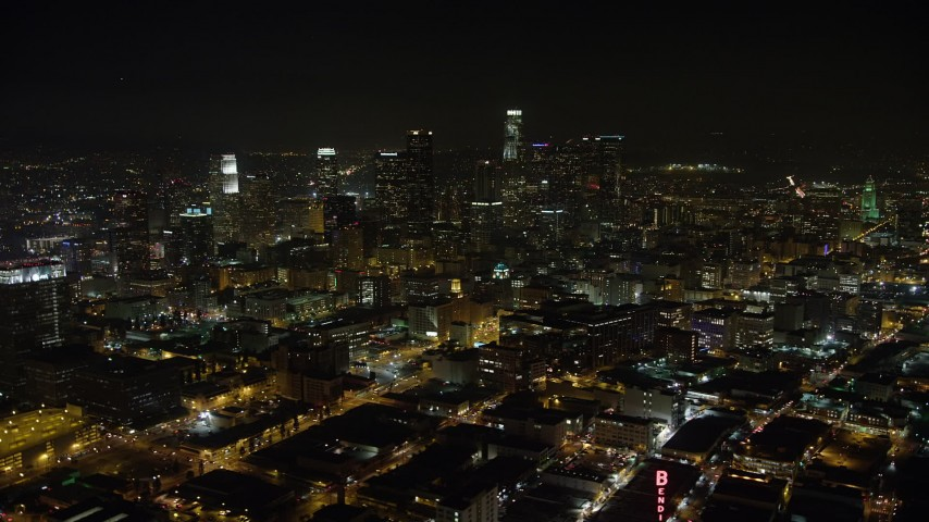 5K stock footage aerial video reverse view of office buildings and Downtown Los Angeles skyscrapers, California, night Aerial Stock Footage | AX64_0360