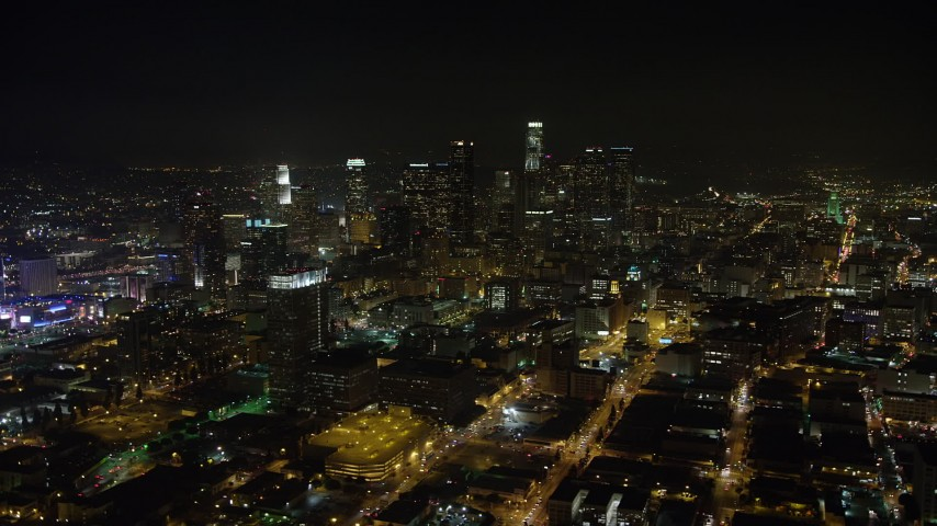5K stock footage aerial video of towering skyscrapers in Downtown Los Angeles at night, California Aerial Stock Footage | AX64_0361