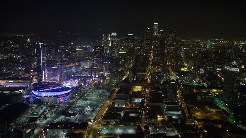 5K stock footage aerial video of Downtown Los Angeles skyscrapers, reveal Staples Center, California, night Aerial Stock Footage | AX64_0362