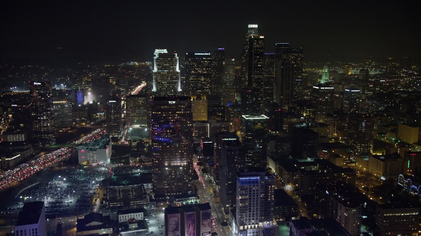 5K stock footage aerial video of approaching the tall skyscrapers of Downtown Los Angeles, California, night Aerial Stock Footage | AX64_0364
