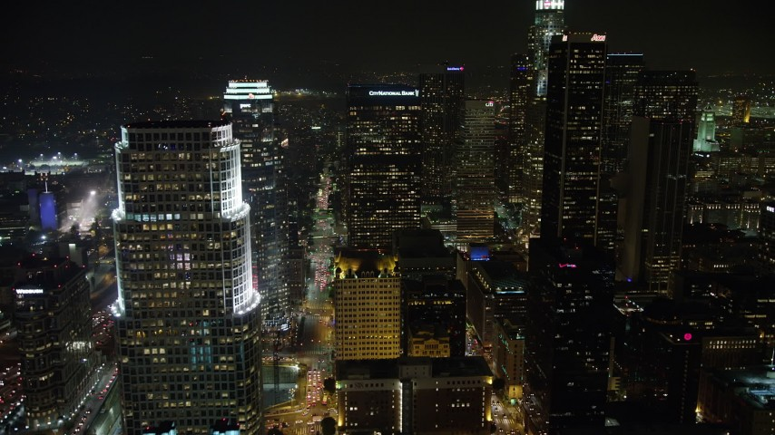 5K stock footage aerial video of towering Downtown Los Angeles skyscrapers at night, California Aerial Stock Footage | AX64_0365