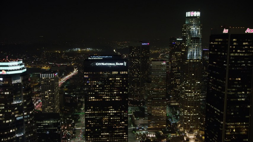 5K stock footage aerial video of flying over tall skyscrapers in Downtown Los Angeles, California, night Aerial Stock Footage | AX64_0366