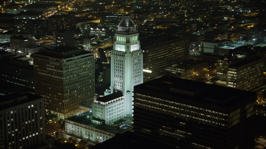 5K stock footage aerial video orbit Los Angeles City Hall at night, Downtown Los Angeles, California Aerial Stock Footage | AX64_0369