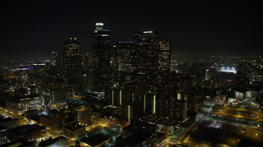 5K stock footage aerial video of approaching Downtown Los Angeles' tall skyscrapers, California, night Aerial Stock Footage | AX64_0371