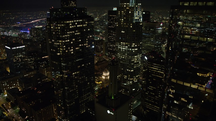 5K stock footage aerial video approach Downtown Los Angeles skyscrapers and reveal the LA Public Library, California, night Aerial Stock Footage | AX64_0372