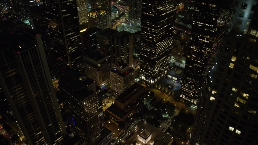 5K aerial video tilt to bird's eye of The Standard in Downtown Los Angeles, California, night Aerial Stock Footage | AX64_0373