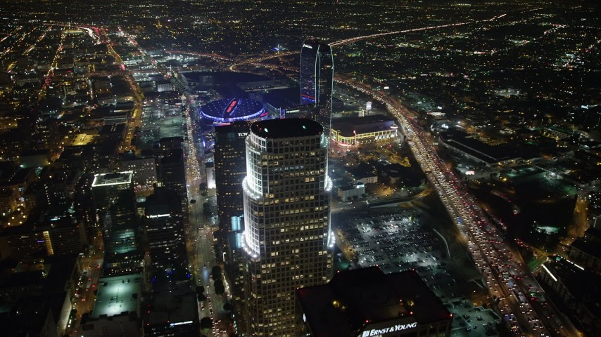 5K stock footage aerial video of 777 Tower, Staples Center, and The Ritz-Carlton Hotel, Downtown Los Angeles, California, night Aerial Stock Footage | AX64_0374