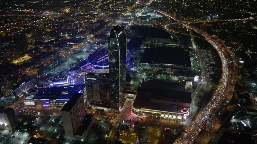 5K aerial video flyby JW Marriott, The Ritz-Carlton Hotel and Staples Center in Downtown Los Angeles, California, night Aerial Stock Footage | AX64_0375