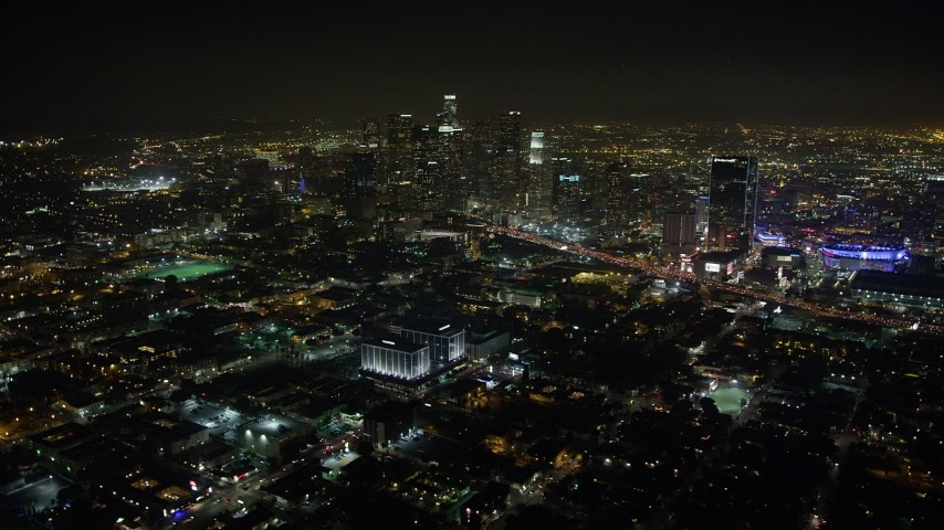 5K stock footage aerial video of Downtown Los Angeles' towering skyscrapers and city sprawl, California, night Aerial Stock Footage | AX64_0376