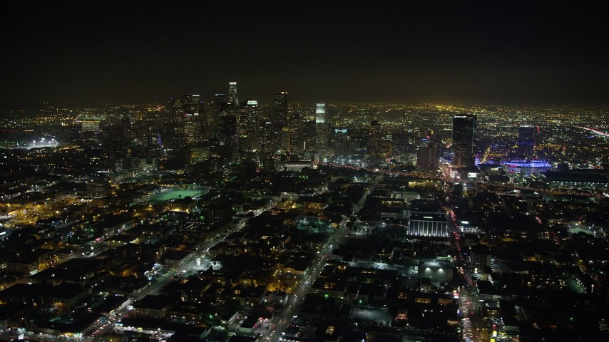 5K stock footage aerial video of Downtown Los Angeles skyscrapers seen across city sprawl, California, night Aerial Stock Footage | AX64_0377