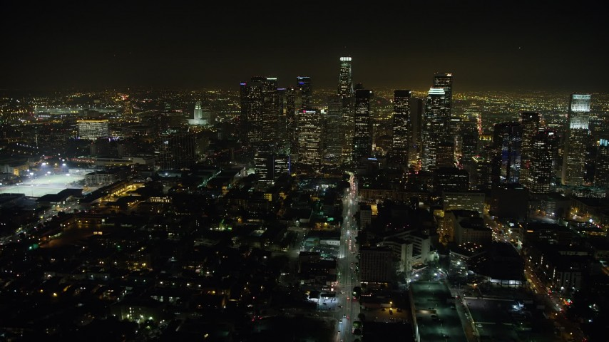 5K stock footage aerial video follow 6th Street to approach Downtown Los Angeles, California, night Aerial Stock Footage | AX64_0380