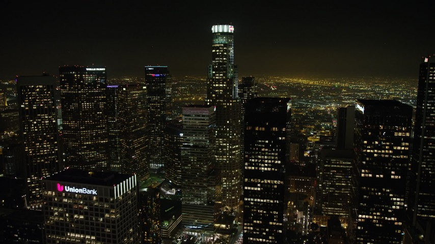 5K aerial video of an approach to US Bank Tower in Downtown Los Angeles, California, night Aerial Stock Footage | AX64_0382
