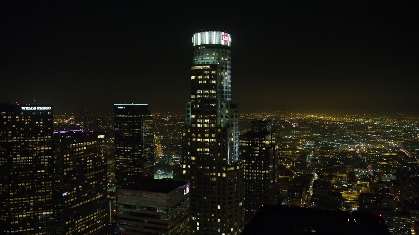 5K stock footage aerial video approach the top of US Bank Tower, Downtown Los Angeles, California, night Aerial Stock Footage | AX64_0383