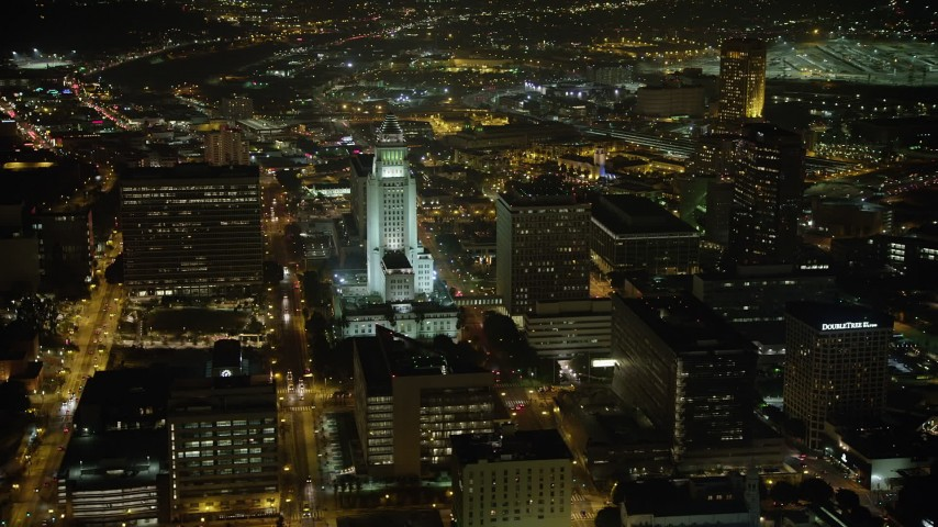 5K stock footage aerial video of passing Los Angeles City Hall, Downtown Los Angeles, California, night Aerial Stock Footage | AX64_0384