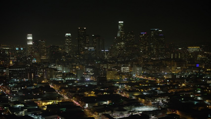 5K stock footage aerial video of a view north at the Downtown Los Angeles skyline, California, night Aerial Stock Footage | AX64_0387