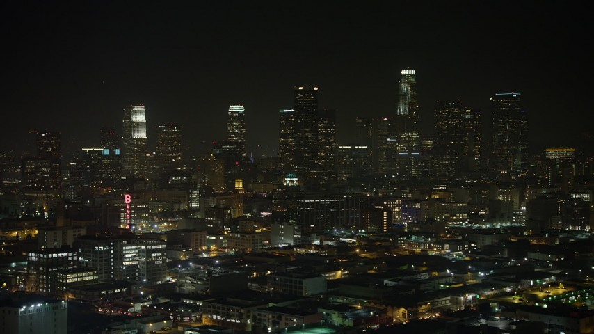 5K stock footage aerial video Bendix Sign and Downtown Los Angeles skyline, California, night Aerial Stock Footage | AX64_0388