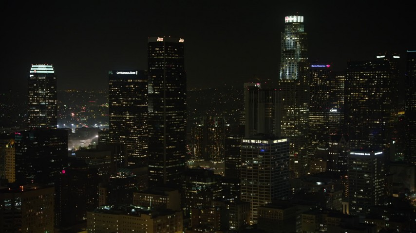 5K stock footage aerial video approach Aon Center in Downtown Los Angeles, California, night Aerial Stock Footage | AX64_0391