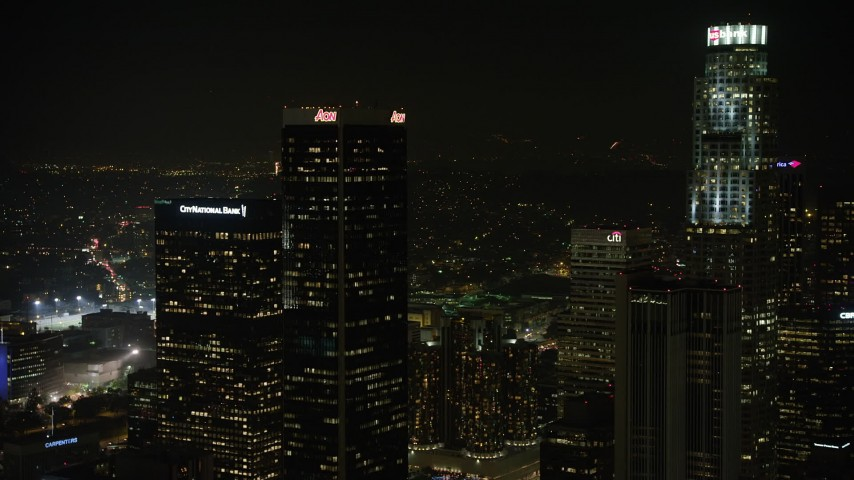 5K aerial video approach Aon Center and tilt to Westin Bonaventure Hotel, Downtown Los Angeles, California, night Aerial Stock Footage | AX64_0392