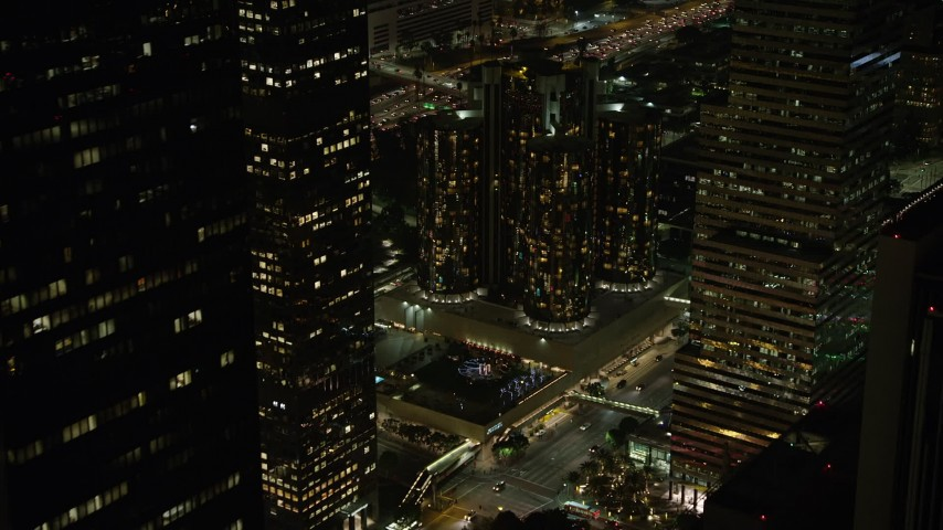 5K stock footage aerial video approach the Westin Bonaventure Hotel, Downtown Los Angeles, California, night Aerial Stock Footage | AX64_0393