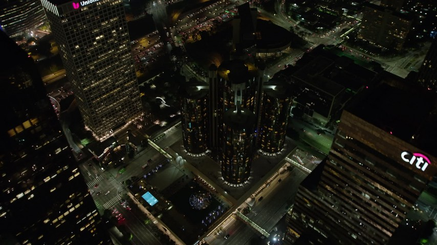 5K stock footage aerial video tilt to bird's eye of Westin Bonaventure Hotel and city streets, Downtown Los Angeles, California, night Aerial Stock Footage | AX64_0394