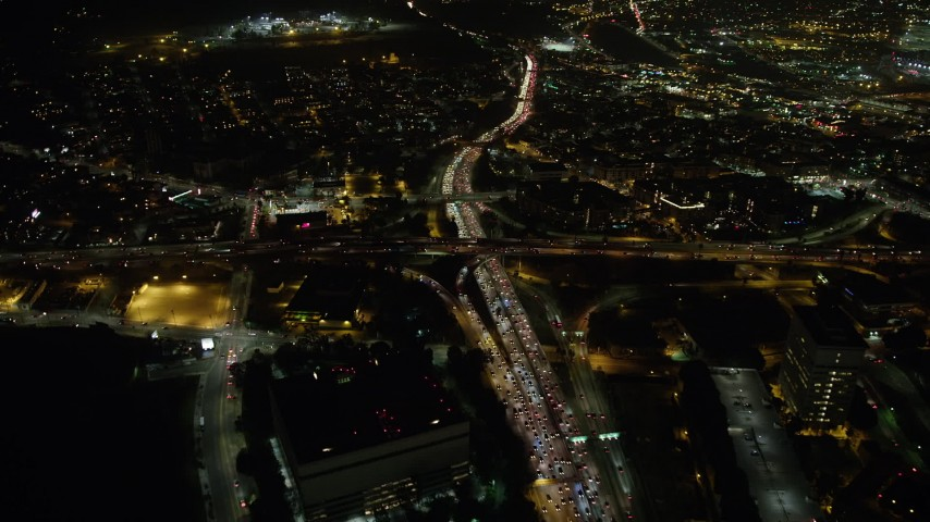 5K stock footage aerial video bird's eye of heavy traffic on the 110 and 101 freeway interchange, Downtown Los Angeles, California, night Aerial Stock Footage | AX64_0395