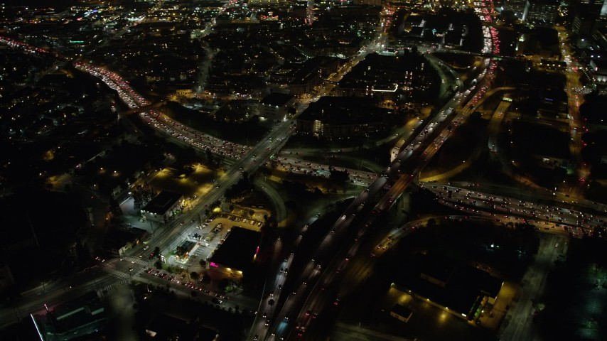 5K stock footage aerial video of the 110 and 101 freeway interchange, Downtown Los Angeles, California, night Aerial Stock Footage | AX64_0396