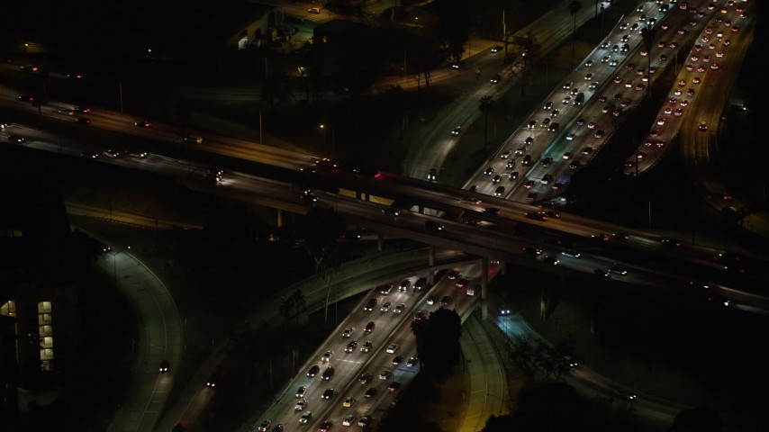 5K stock footage aerial video of Highway 110 and Highway 101 freeway interchange, Downtown Los Angeles, California, night Aerial Stock Footage | AX64_0397