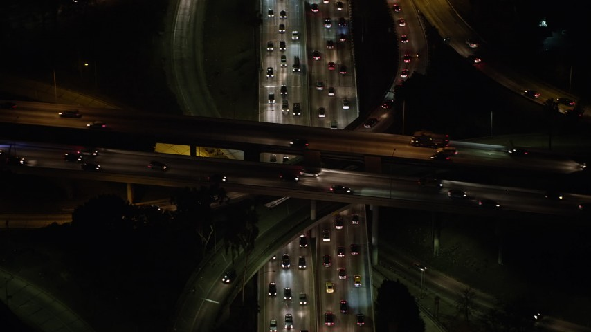 5K stock footage aerial video tilt to a bird's eye view of cars on the 110 and 101 interchange, Downtown Los Angeles, California, night Aerial Stock Footage | AX64_0398