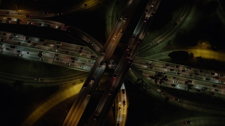 5K stock footage aerial video bird's eye view of Highway 110 and Highway 101 interchange, Downtown Los Angeles, California, night Aerial Stock Footage | AX64_0399
