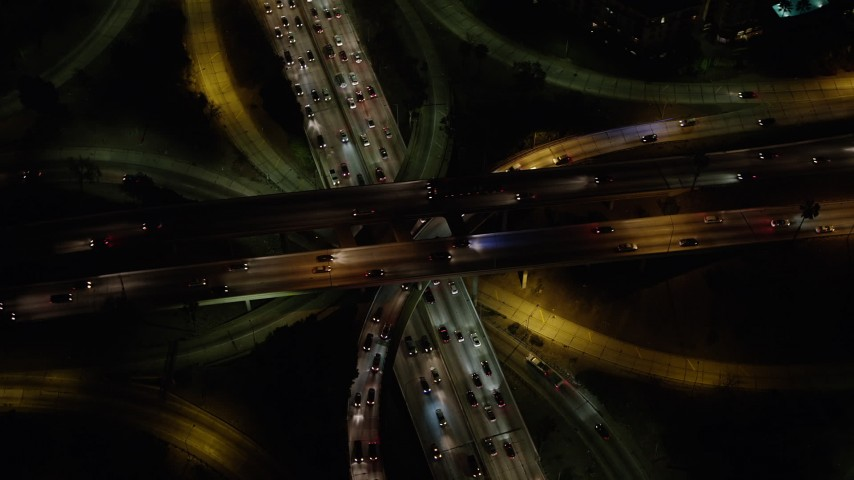 5K aerial video bird's eye of traffic on the 110 / 101 freeway interchange, Downtown Los Angeles, California, night Aerial Stock Footage | AX64_0400