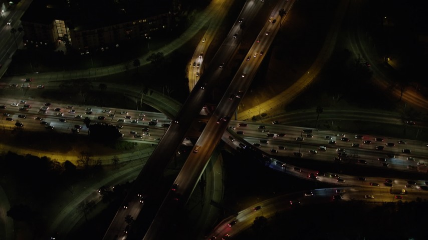 5K aerial video of the 110 and 101 freeway interchange in Downtown Los Angeles, California, night Aerial Stock Footage | AX64_0401